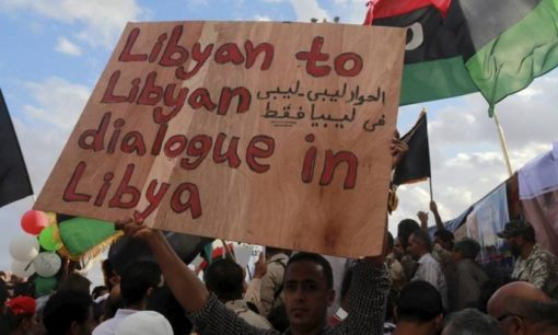 A man holds a sign during a protest in Benghazi, Libya, October 2015.  © Reuters/Esam Omran Al-Fetori