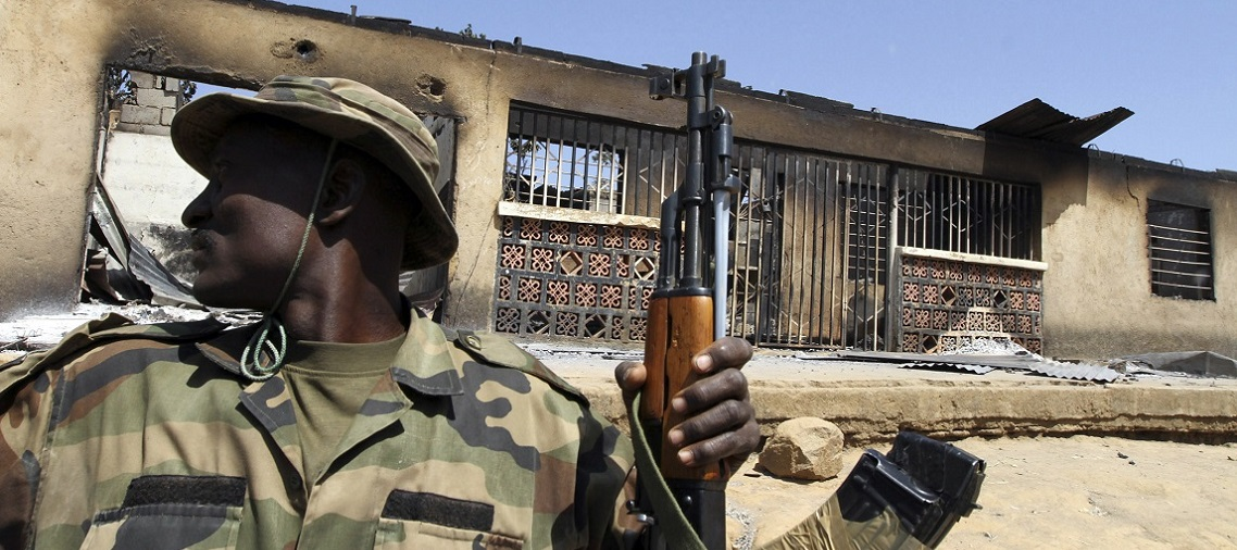 A soldier sits in a truck during a military patrol in Nigeria's central city of Jos. © Reuters - Akintunde Akinleye